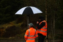 Marshals shelter from the rain