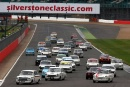 Silverstone Classic 2016, 29th-31st July, 2016,Silverstone Circuit, Northants, England. Wolfe-Meaden Ford Lotus Cortina lead at the start Copyright Free for editorial use only