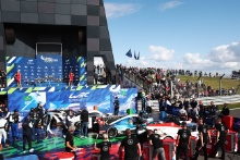 The class winning cars at the end of the race
