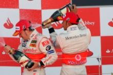 Fernando Alonso (ESP), McLaren Mercedes and Lewis Hamilton (GBR), McLaren Mercedes on the podium