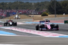 23.06.2019 - Race, Sergio Perez (MEX) Racing Point F1 Team RP19 leads Antonio Giovinazzi (ITA) Alfa Romeo Racing C38