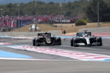 23.06.2019 - Race, Kevin Magnussen (DEN) Haas F1 Team VF-19 and Lewis Hamilton (GBR) Mercedes AMG F1 W10