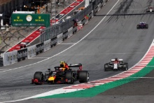 30.06.2019 - Race, Pierre Gasly (FRA) Red Bull Racing RB15 Kimi Raikkonen (FIN) Alfa Romeo Racing C38 and